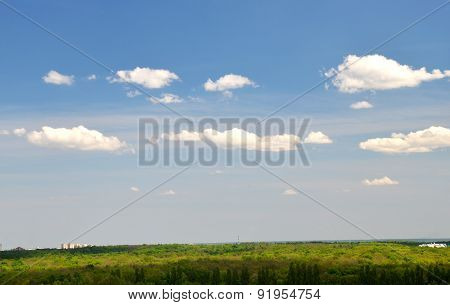 White Clouds Flying Over Green Grass And Trees