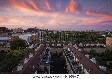 Sunsrise Above Apartment Buildings