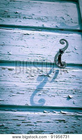 Rustic shadow of shutter scroll hook