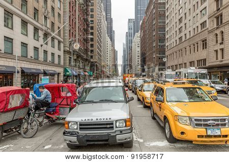 NEW YORK, USA - CIRCA MAY 2015: Vehicles move along 5th Avenue in New York City.