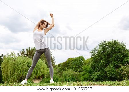 Pretty young woman doing stretching