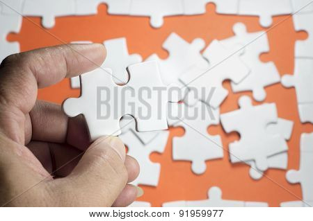 Hand Holding Puzzle