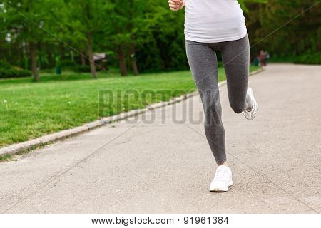 Close up of woman running in park