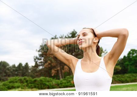 Young woman with hands on her head