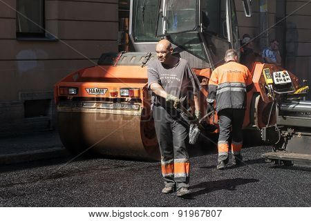 Asphalting In Progress With Workers And Asphalter