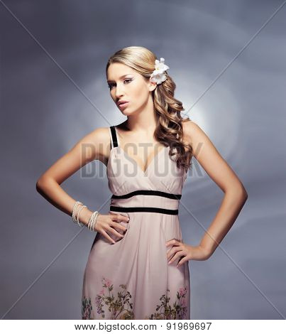 Beautiful and young woman posing over the bizarre background