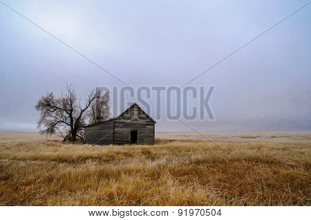 Old Abandoned Barn In An Open Field On An Icy Morning