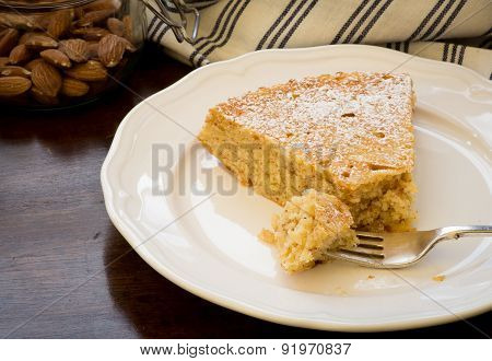Lemon Almond Cake Slice With Fork On White Plate