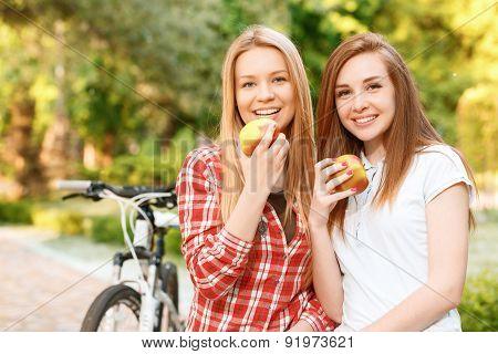 Young girls relaxing after bike riding