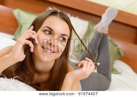 Girl at home hanging on phone.