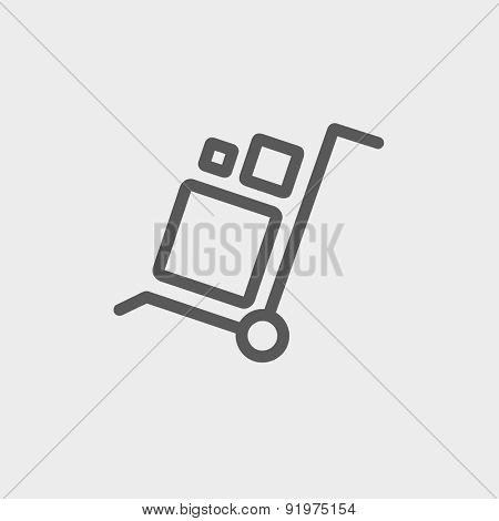 Trolley with boxes icon thin line for web and mobile, modern minimalistic flat design. Vector dark grey icon on light grey background.