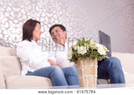 Couple at home sitting on sofa