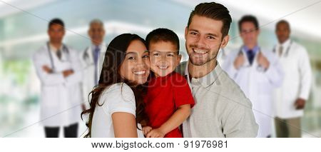 Group of doctors and a family set in a hospital