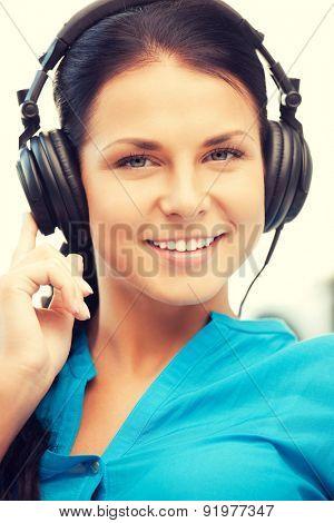 picture of happy teenage girl in big headphones