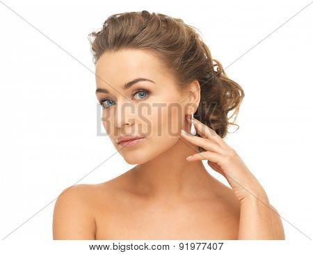 beautiful woman in white dress and diamond earrings