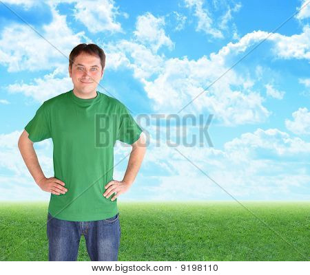 Green Nature Man Standing in Clouds and Grass