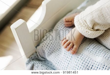 Tiny feet of a newborn child