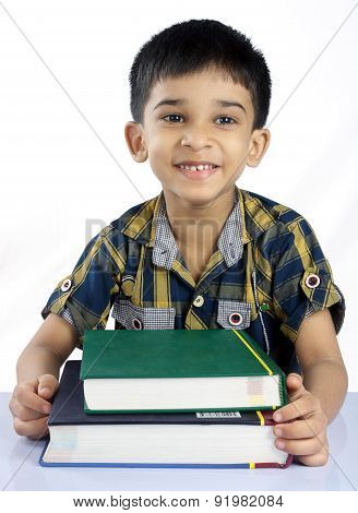 Portrait of Indian Little Boy with Textbooks
