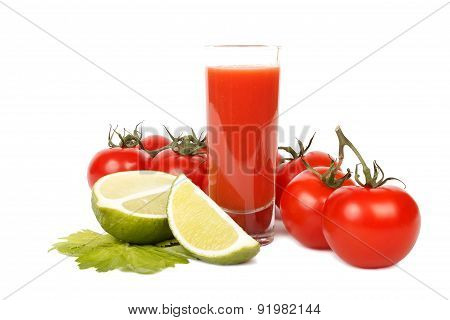 Tomato juice, lime and bunch of tomatoes over white.