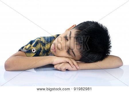 Portrait of School Boy Sleeping on Desk