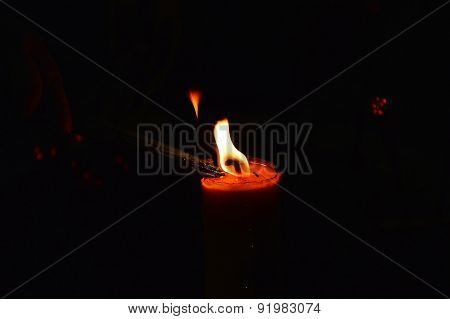 Joss stick fire on candle