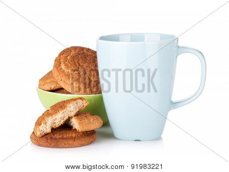 Cup of milk and bowl with cookies. Isolated on white background