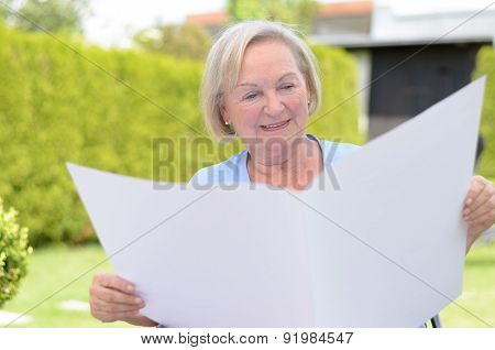 Elderly Lady Holding A Blank Paper
