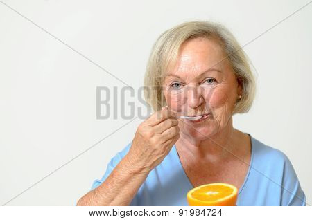 Happy Healthy Senior Lady With A Orange