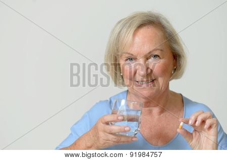Elderly Lady Taking The Prescribed Dose Of Medicine