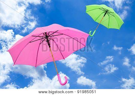 Multicolored Umbrella Against The Sky