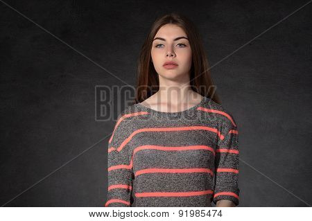 Girl Shows Sadness Against The Dark Background