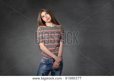 Woman Shows Boredom Against A Dark Background