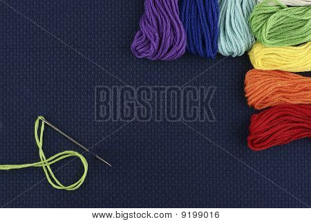 Dark blue outline with threads