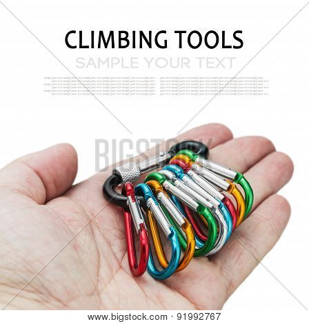Colorful Carabiner Climbing In Hand Isolated On White