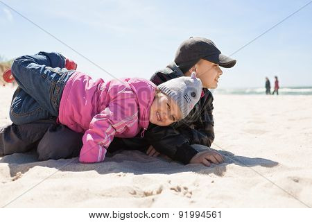 children playing fun, emotional,on beach,spring season clothes