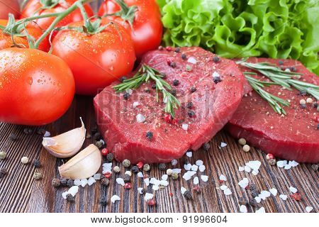 Raw Beef Steak With Vegetables And Spices