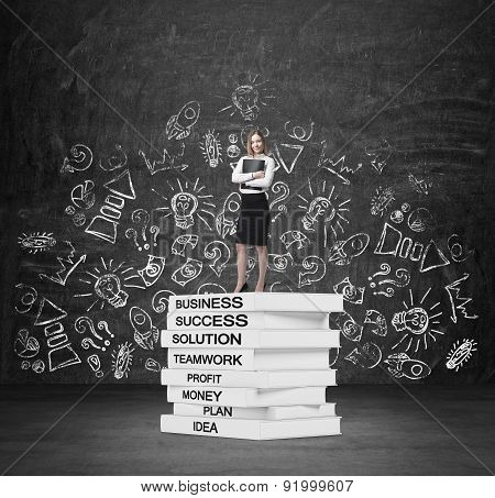 Young Lady With A Black File Is Standing On The Top Of The Book' Pedestal