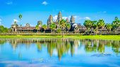 stock photo of reflection  - Angkor Wat temple with palms and reflection in the lake over the blue sky i - JPG