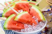 foto of popsicle  - Watermelon slice popsicles on serving plate with ice - JPG