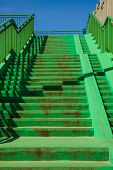 stock photo of stairway  - Green concrete stairs stairway with railing handrail on sunny day - JPG