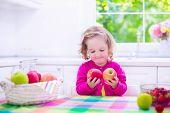 stock photo of little young child children girl toddler  - Child eating breakfast - JPG
