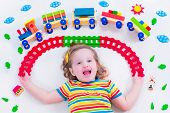 pic of railroad car  - Child playing with wooden train - JPG