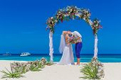 picture of wedding arch  - young loving couple - JPG