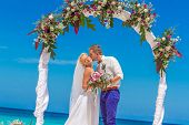 image of wedding arch  - young loving couple - JPG