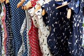 picture of rockabilly  - Colorful Rockabilly polka dot dresses on hangers display - JPG