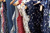 stock photo of hillbilly  - Colorful Rockabilly polka dot dresses on hangers display - JPG