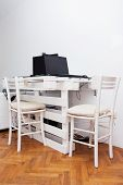 pic of wooden pallet  - White storage industrial pallet used in home office as a computer desk - JPG