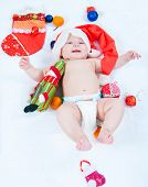 foto of new years baby  - The image of the kid lying among New Year - JPG