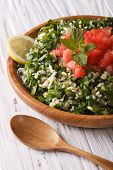 foto of tabouleh  - Tabbouleh salad closeup in a wooden bowl on the table - JPG