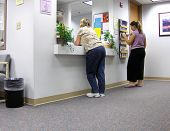 image of doctors office  - patients at a doctors office waiting to be seen - JPG